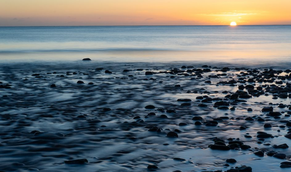 stonehaven sunset over gently lapping waves and shoreline