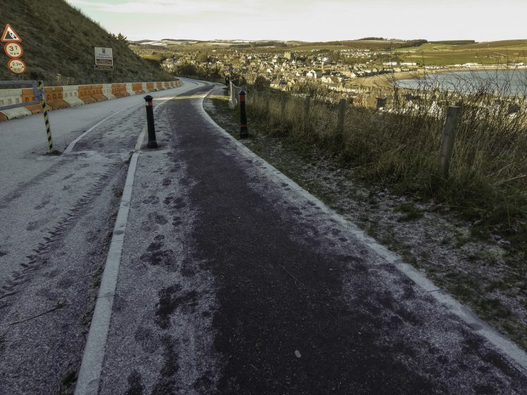 frost road with salted pavement