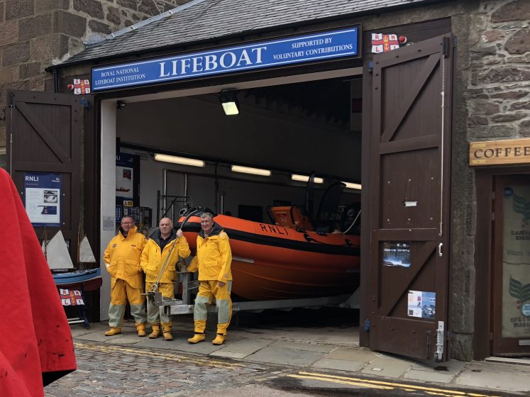 lifeboat members by rescue craft