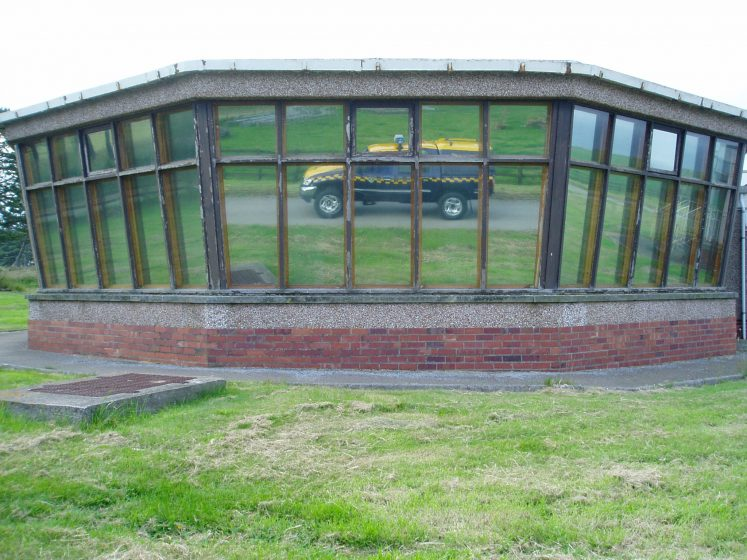 coastguard land rover reflected in windows of former Stonehaven Radio building