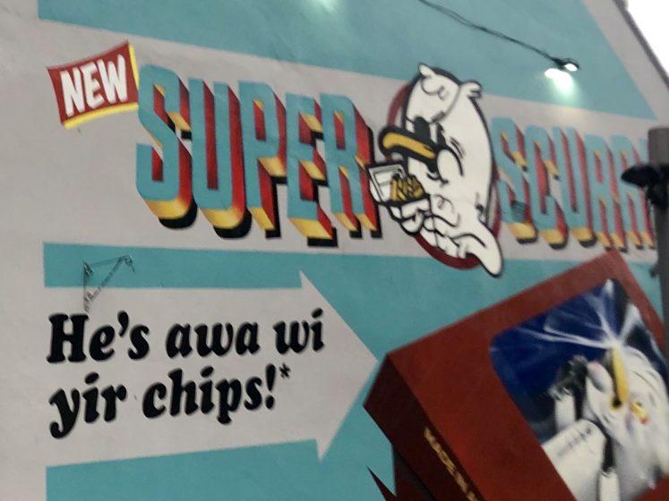 wall mural in Aberdeen cartoon of 'super scurry' caption He's awa wi yir chips'