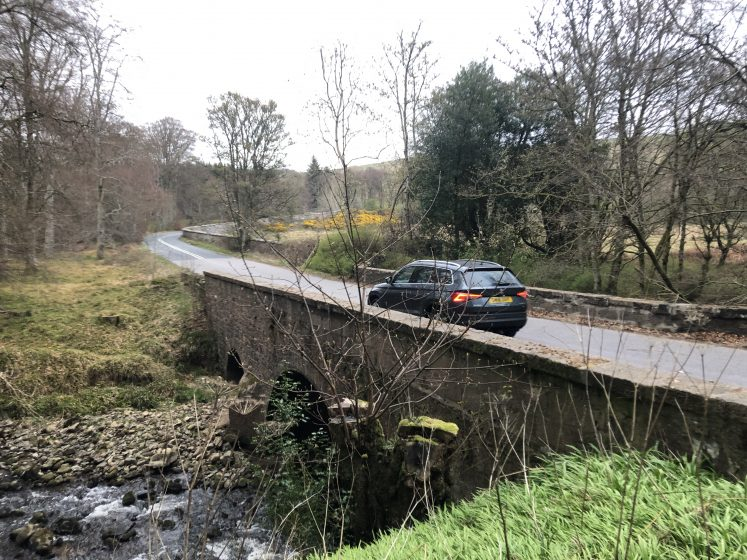 Car crossing the Findlayston bridge with its old stone arches