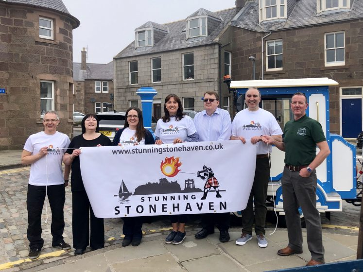 group from SBA with Jackie Lockhart - all holding up a banner with the stunning stonehaven logo