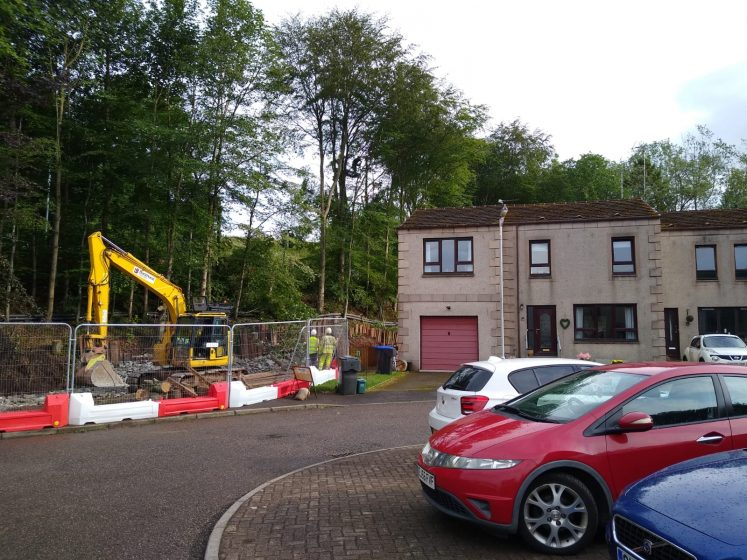 digger outside house in Carron Gardens