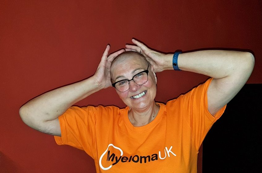 linda with shaved head and huge smile