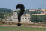 photo of ury house in ruin state with question mark superimposed
