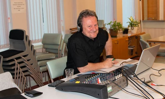 Man with headphones and recording gear