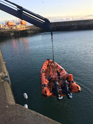 lifeboat being winched out of the water