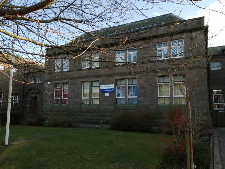 the imposing sandstone facade of Arduthie School