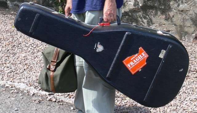 guitar case with sticker on it saying 'fragile'