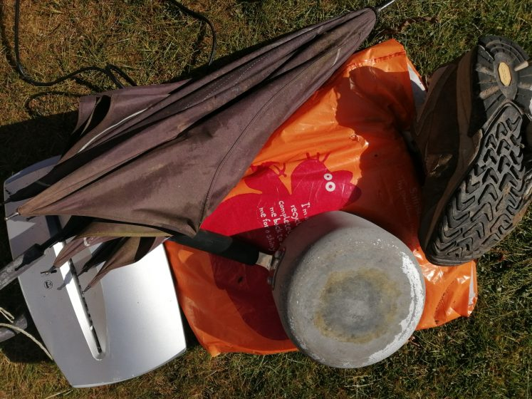 collection of waste - old brolly, pot, walking boots