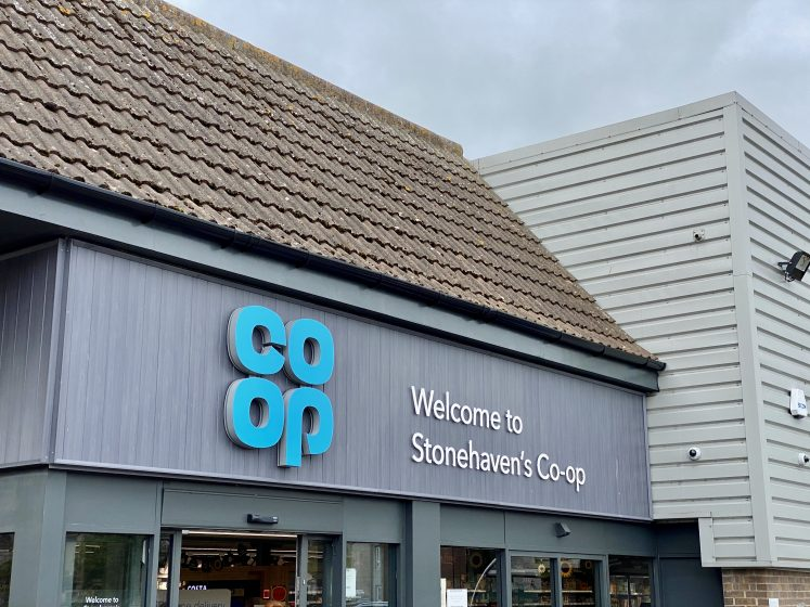 a detail of Stonehaven's Coop building with logo