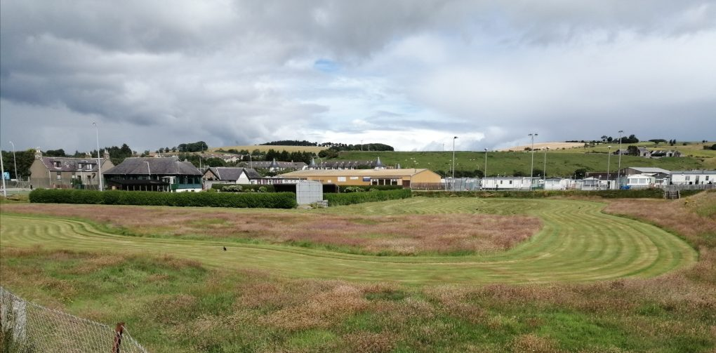 view of grounds across putting green