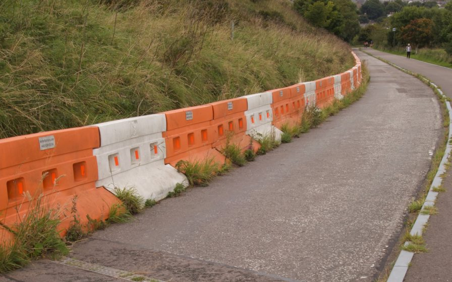 water barriers with weeds