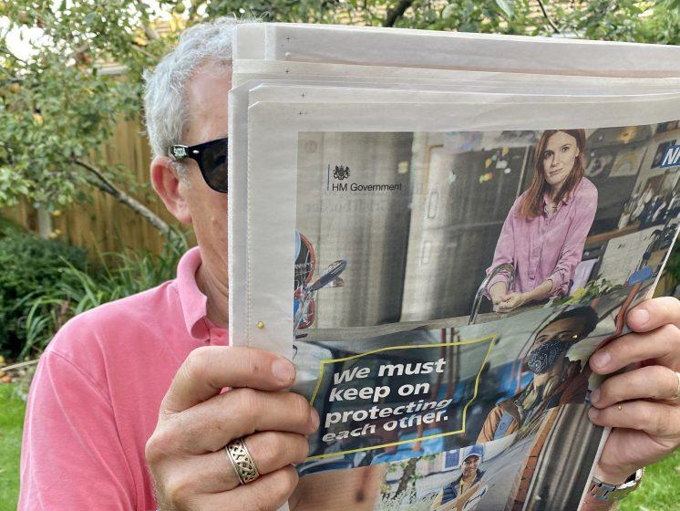 John reading a newspaper