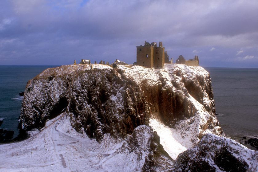 beautifully composed shot of Dunnottar Castle with snow showing rock features