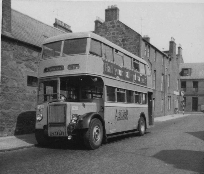 old black and white photo of double decker bus