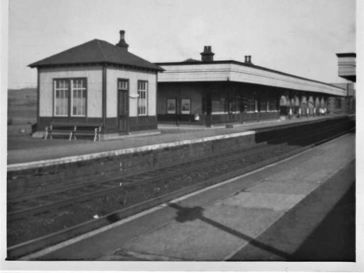 black and white image of train station
