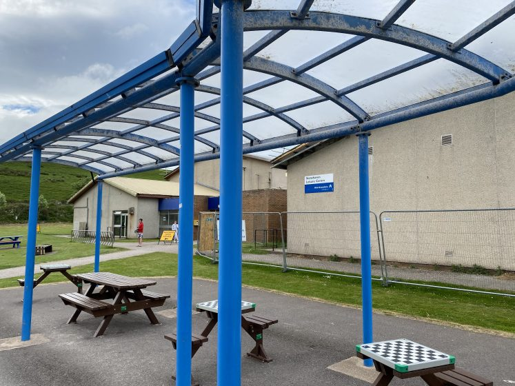 image of leisure centre from covered picnic area in front