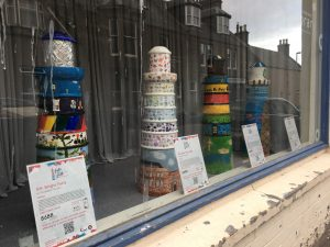 Mini Lighthouses in the Library window