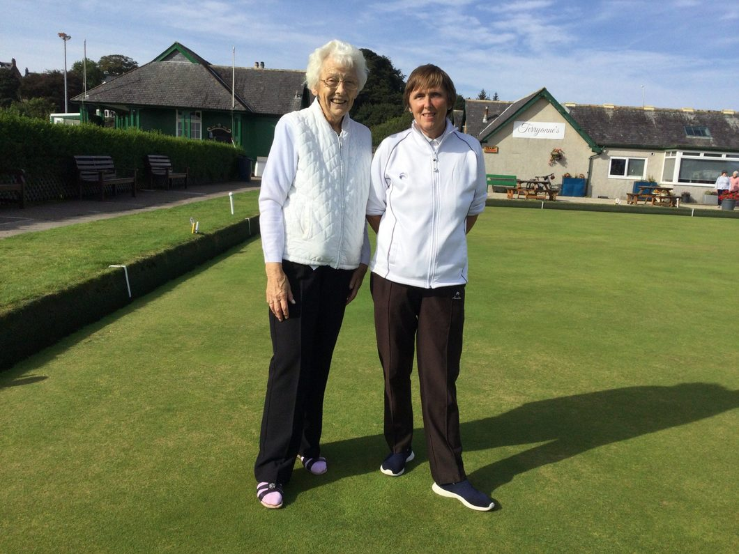 Two ladies on bowling green