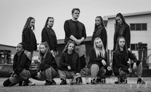 strong black and white image of a teenage dance group